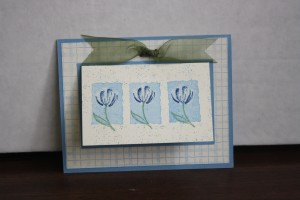 "This card was made using the KISS technique.  I inked up the rectangle, then ""kiss""ed it with the petal part of the tulip to remove ink in that design from the rectangle.  I then came in with the darker blue color and stamped the petal part over that spot.  It gave this card a beautiful look!"