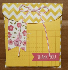This yellow chevron mini bag/envelope is from the PaperSource at Hobby Lobby.  I added a square Ghirardelli chocolate and a thank you square - they both fit perfectly.  To add more color I sewed a banner to the thank you square, added a button, and a twine bow up on the flap!