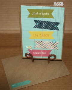 Card made using 5 of the banner cutouts and sewing them to some ledger like background paper.  The card itself is from the Paper Source found at Hobby Lobby.  Added a couple brads and a button to add texture to this card!!