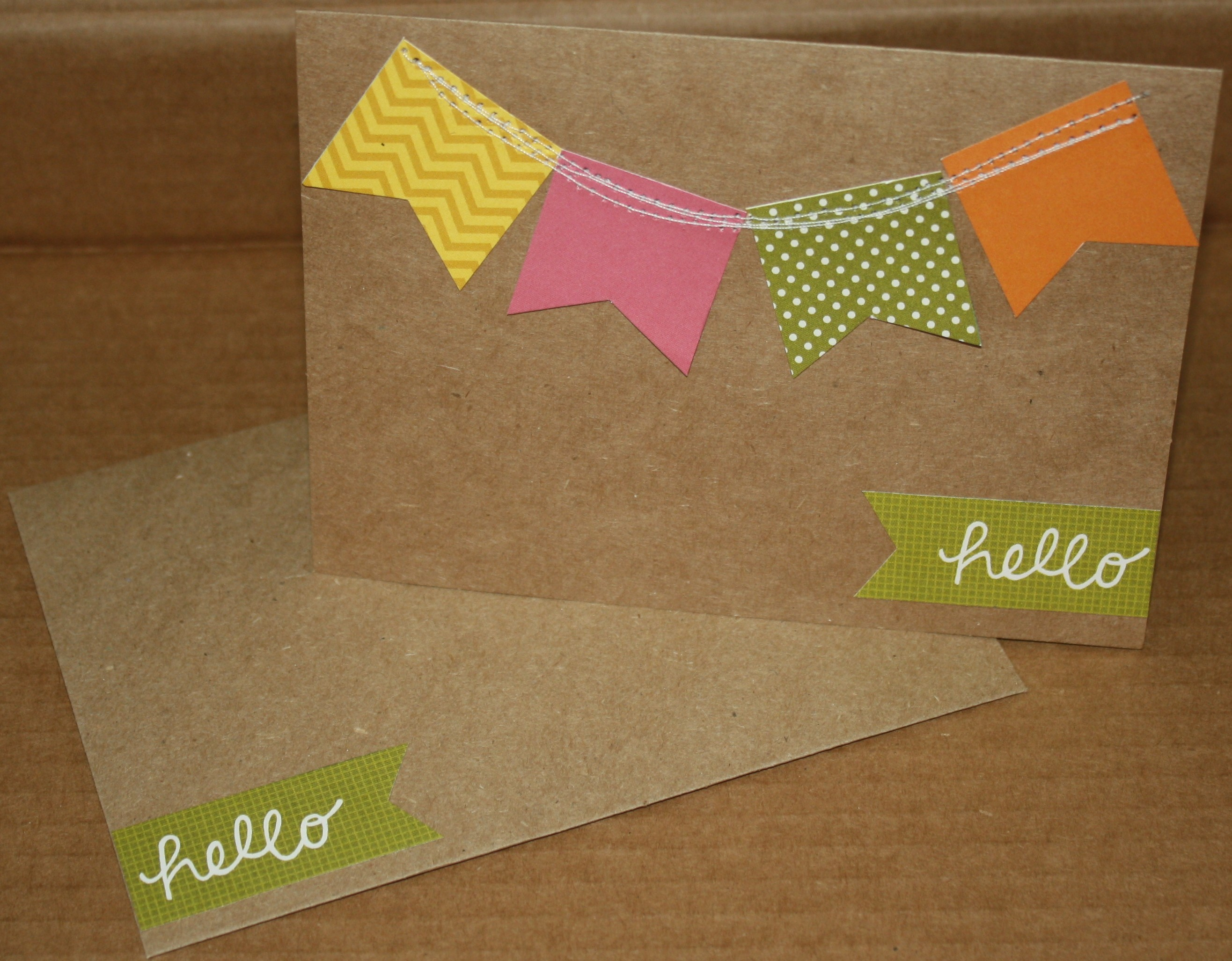 Using a premade Kraft card from a package I found at Hobby Lobby by Paper Studio this card was a cinch to make!! I took the 4 banner pieces that were the same size and sewed them onto the card with my sewing machine and then I added the green hello pennant!  How cute and simple was that?!?