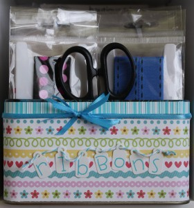 A tin that was repurposed to be used as a holder for my Doodlebug Design brand ribbon packages!