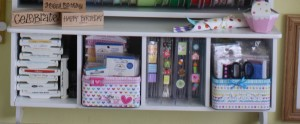 This is the 4 cubby shelf that I put 2 of my repurposed tins in to hold favorite products!