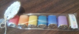 Wrapped Hershey nuggets with labels I added color to!  Lined up in a cello bag for pretzel rods by Wilton!