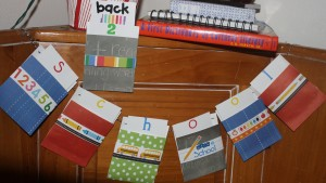 Library style pockets banner made to hang in the corner of our bench seating area in our kitchen!