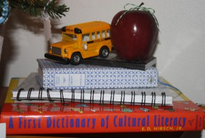 Made this display from a few books we had around the house! A toy school bus and an apple tied with twine completed this arrangement!