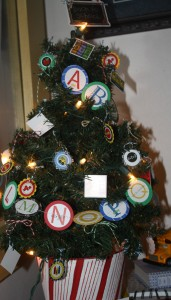 Our Back to School tree - decorated with twine bows and mini school icon ornaments and an alphabet letters garland!!