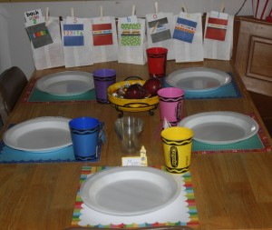 A view of the 12 by 12 paper I used as placemats from a Back to School Paper collection!  Got the adorable crayon cups in the party section of my grocery store!